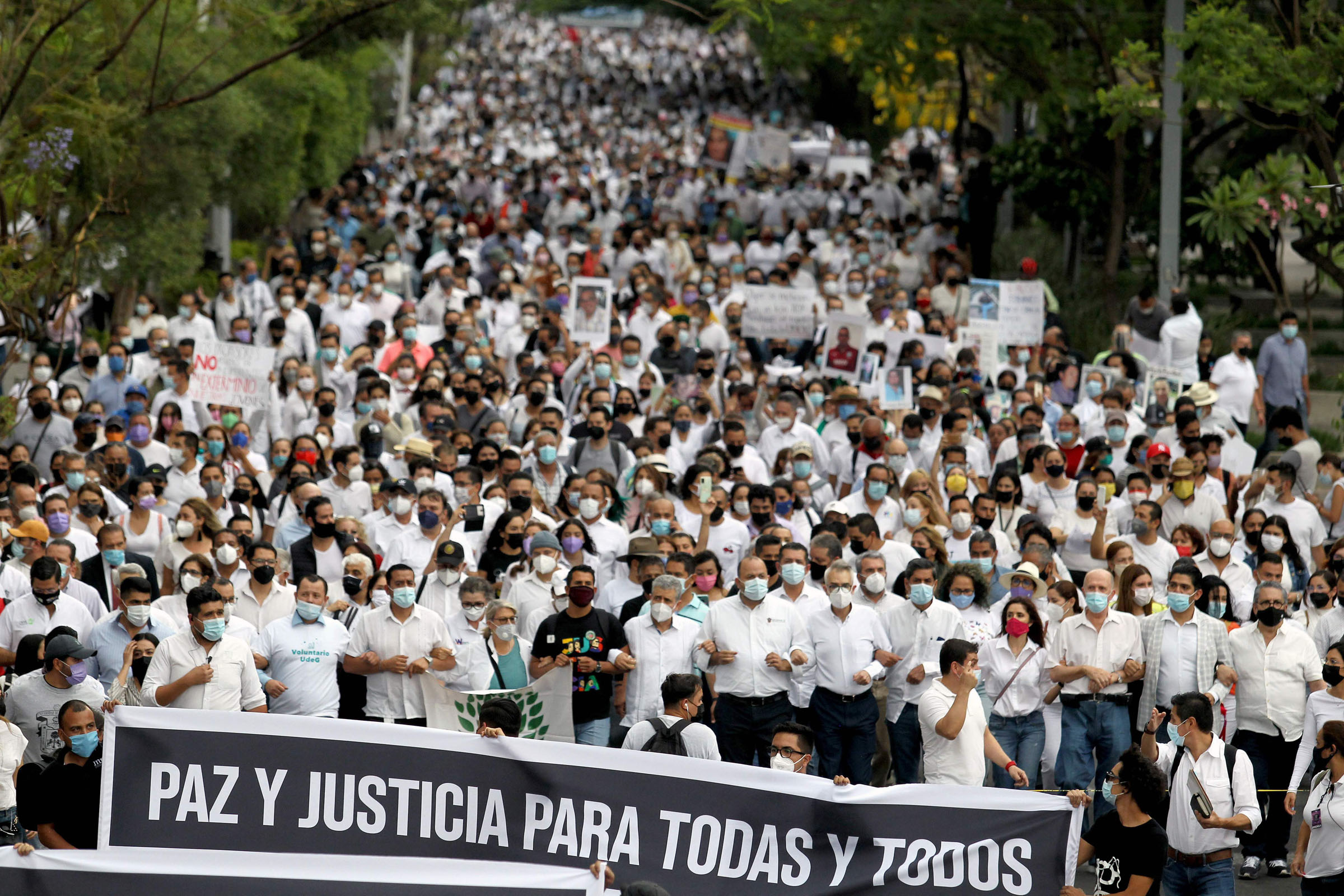 Students, teachers and activists participate in the 'March of Peace and Justice' demanding justice to the Mexican government on the case of three siblings Ana Karen, Luis Angel and Jose Alberto Gonzalez who were found dead after been abducted from their home by an armed group, in Guadalajara, Jalisco state, Mexico, on May 11, 2021. (Photo by ULISES RUIZ / AFP)